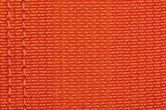Orange color textile surface. Close up view stock photography