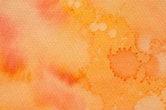 Orange watercolor ink painted on paper background texture royalty free stock image