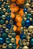 Bokeh lights with Christmas baubles stock image