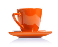 Orange colored coffee cup isolated on white background Royalty Free Stock Photo