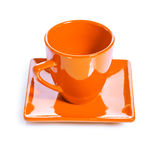 Orange colored coffee cup Stock Images