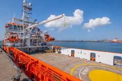 Orange colored EU ship for fishery inspection in the port of IJmuiden, the Netherlands. stock image