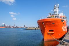 Orange colored EU ship for fishery inspection in the port of IJmuiden, the Netherlands. stock photo