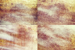 Orange colored grunge texture backgrounds. Four orange colored grunge texture backgrounds in one set Royalty Free Stock Image