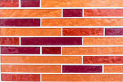Orange colored mosaic tiles Stock Image