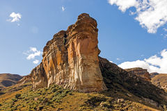Orange colored rocky mountain and blue sky landscape in the Orange Free State in South Africa Royalty Free Stock Images