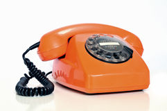 Orange colored telephone stock image