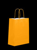 Orange colour carrier bag on black Royalty Free Stock Images