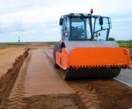 Orange compactor machinery royalty free stock image