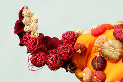 Orange composition with straw and fabric balls for decoration Stock Photo