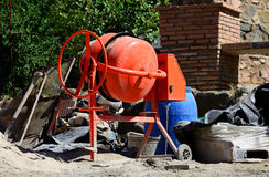 Orange concrete-mixer. Orange cement mixer at a construction work royalty free stock image