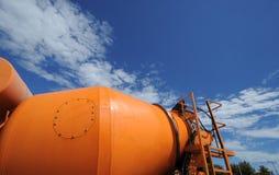 Concrete mixer. Orange concrete mixer working on the blue sky royalty free stock images