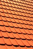Orange concrete roof tiles on a residential home. Roof tiles background texture royalty free stock photography