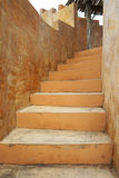 Orange concrete stairs in modern building Royalty Free Stock Photo