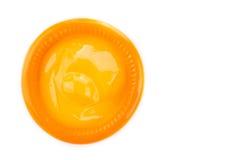 Orange condom. From topview on white background Stock Photo