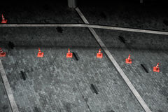 Orange cone. In the floor pattern Royalty Free Stock Images