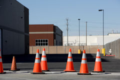 Orange Cones. A row of orange cones warns of danger ahead Royalty Free Stock Photos