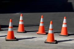 Orange Cones. A row of orange cones warns of danger ahead Royalty Free Stock Photo
