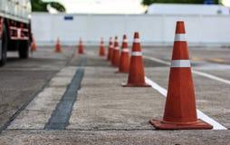 Orange cones direct traffic Stock Photos