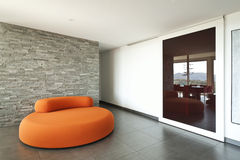 Orange confortable de fauteuil Image libre de droits