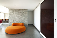 Orange confortable de fauteuil Photo stock