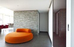 Orange confortable de fauteuil Photos stock