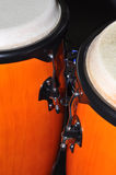 Orange Congas isolated on black background. A pair of orange congas isolated on a black background. These drums, originally from Cuba are suited to a variety of Stock Image