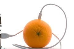 The orange connected through cable. The orange connected through usb cable Royalty Free Stock Images