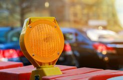 orange construction boards and flashing lights royalty free stock image