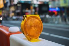 Orange construction boards and flashing lights. On city street, yellow, sign, road, roadblock, roadwork, detour, usa, traffic, transportation, highway, warning stock image