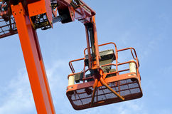 Orange construction crane basket Royalty Free Stock Image