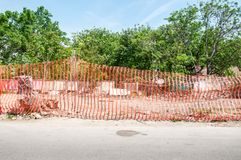 Orange construction site barrier or fence net to protect working place.  stock image