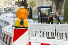 Orange construction Street barrier light on barricade. Road cons. Truction on the streets of European cities. Germany. Mainz stock photography