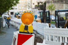 Orange construction Street barrier light on barricade. Road cons Stock Photo