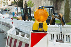 Orange construction Street barrier light on barricade. Road cons Stock Photography