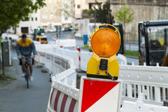 Orange construction Street barrier light on barricade. Road cons Royalty Free Stock Photo