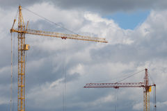 Orange construction tower crane Stock Photos