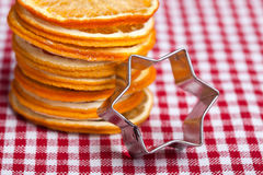 Orange and Cookie Cutter Royalty Free Stock Images