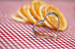 Orange and Cookie Cutter Royalty Free Stock Photography