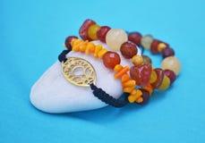 Orange coral gemstone bracelets - gold byzantine jewelry Stock Images