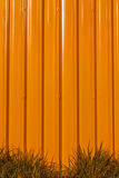 The orange corrugated painted metal wall with small exterior gre Stock Photo
