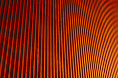 Orange corrugations. Close-up of the side of a factory wall, suitable as background Stock Images
