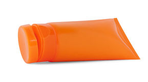 Orange cosmetic tube Stock Images