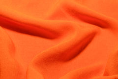 Orange cotton textile factory fabric texture waves and folds background Royalty Free Stock Photos