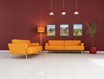 Orange couch in modern living room royalty free stock photography