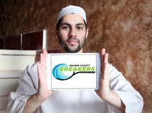 Orange County Breakers Tennis team logo. Logo of Orange County Breakers Tennis team on samsung tablet holded by arab muslim man. The Orange County Breakers are a Royalty Free Stock Image