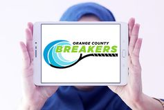 Orange County Breakers Tennis team logo. Logo of Orange County Breakers Tennis team on samsung tablet holded by arab muslim woman. The Orange County Breakers are Stock Photos