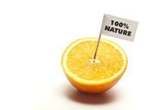 Orange coupée en tranches avec l'indicateur Photographie stock libre de droits