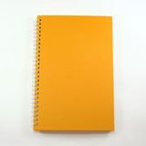 Orange cover note book Stock Image