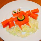 Orange crab of crab sticks on a white plate. Crab of sticks, edi. Ble, on a plate. Food for children. Crab sticks Stock Photo